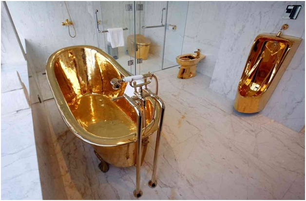 A hotel suite with a bathtub made of gold